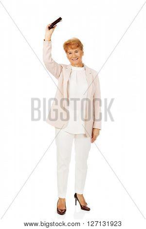 Smile senior woman holding wallet