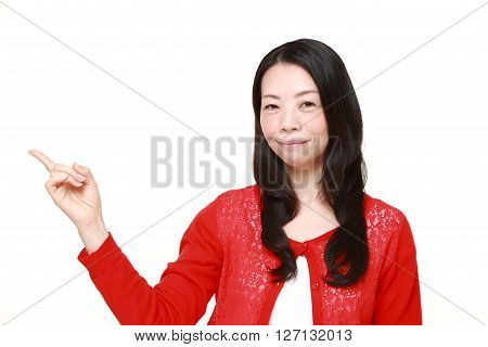 Japanese woman presenting and showing something on white background