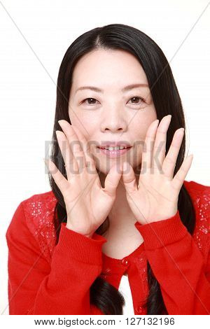 young Japanese woman shout something on white background