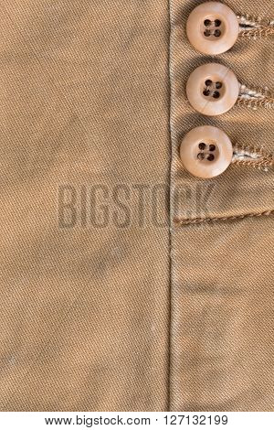 Design Botton Of Brown Shirt On Fabric Textile Background