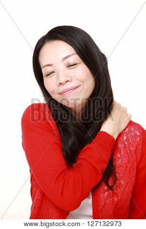 Japanese woman suffers from neck ache on white background