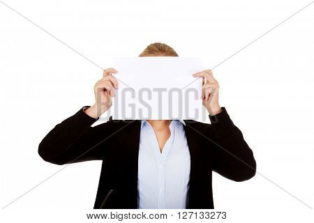 Business woman covering face with blank paper card