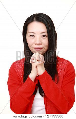 woman folding her hands in prayer on white background