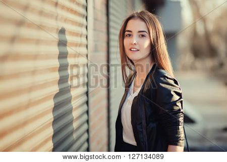 Young beautiful urban girl staring copy space.