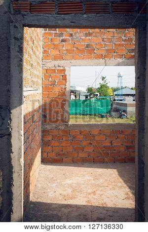 Wall Made Brick And Door Structure In Residential Building Construction Site