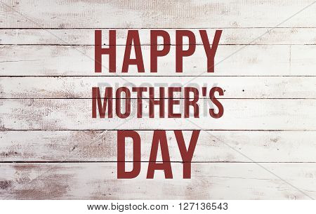 Mothers day composition. Red sign on white board. Studio shot on wooden background.