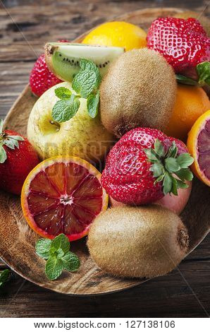 Mix Of Fresh Fruits On The Wooden Table