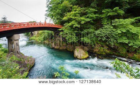 Silk water, long exposure of Shinkyo Bridge in Nikko, Japan. Rear view