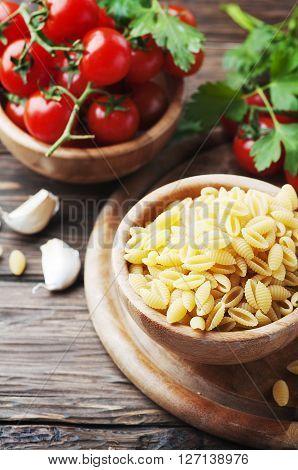 Sardinian raw pasta malloreddus with tomato selective focus