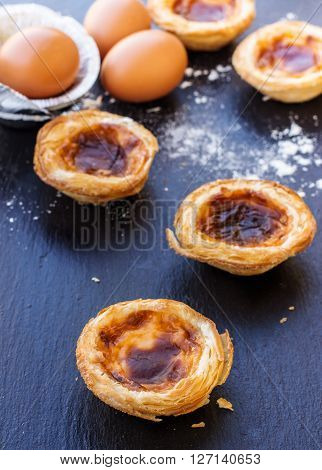 Egg tart on a grunge background, traditional portugueser dessert, pasteis de nata. Selective focus