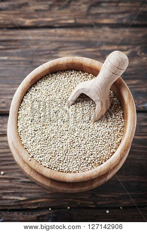 Raw Healthy Quinoa On The Wooden Table