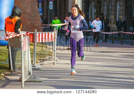 Krakow Poland - December 31 2015: 12th New Year's Eve Race in Krakow. The people running dressed in funny costumes
