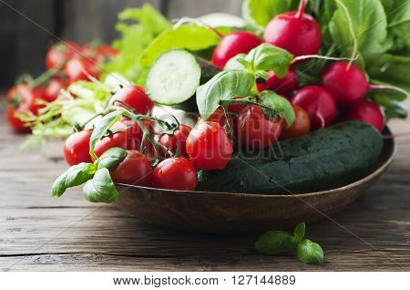 Mix Of Fresh Vegetables On The Wooden Table