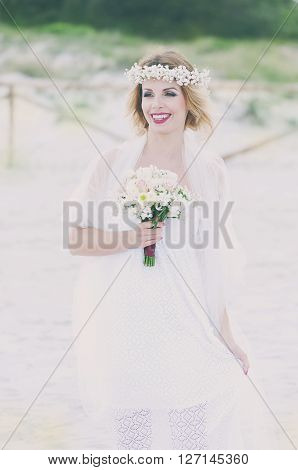 Beautiful blond fiancee in white wedding dress selective focus