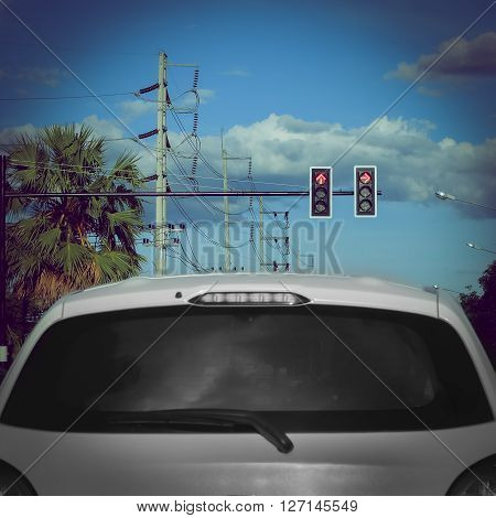 Red Traffic Light On Road With Car Stop On Street