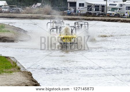 NAPLES FLORIDA/USA - MARCH 3 2012: Swamp buggy in Jeep class pushes rooster tail directly into cockpit