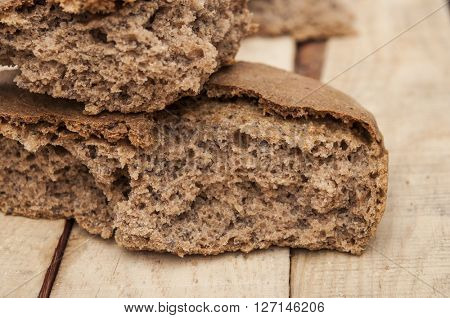 homemade rye bread broken into pieces