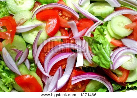 A Platter Of Various Fresh Salad Items Ready For Surving.