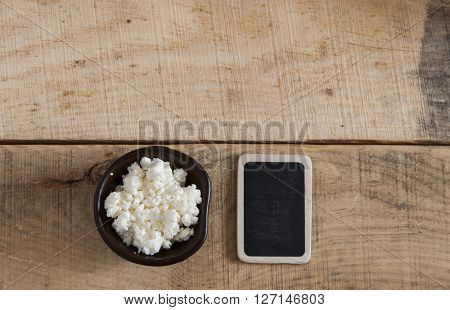 Breakfast cottage cheese on wooden table