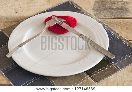 Heart on plate with fork and knife
