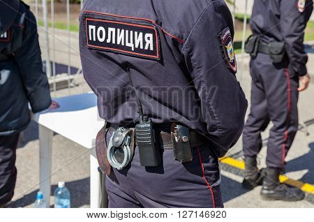 SAMARA RUSSIA - APRIL 24 2016: Equipment on the belt of Russian policeman. Text in russian: