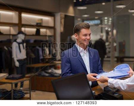 Young man shopping in store