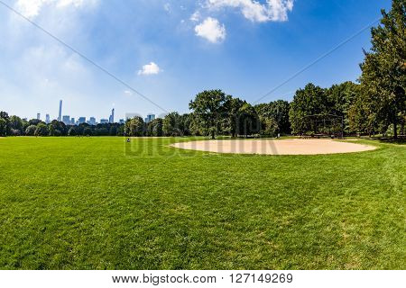 NEW YORK - SEPTEMBER 19, 2015: Views of the from the big meadow Central Park to Midtown New York on September 19 2015. The Central Park is a famous Park in the centre of Manhattan New York.