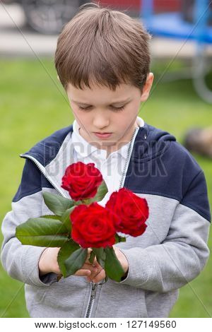 Boy With A Bouquet Of Roses For His Mother