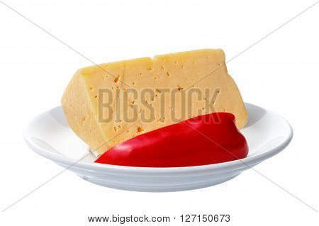 Pieces of cheese and sweet pepper lying on a plate. Objects on a white background.