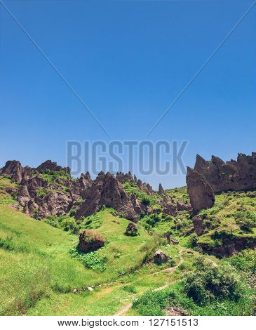 View on mountain cliffs and magnificent blue sky on background. Exploring Armenia