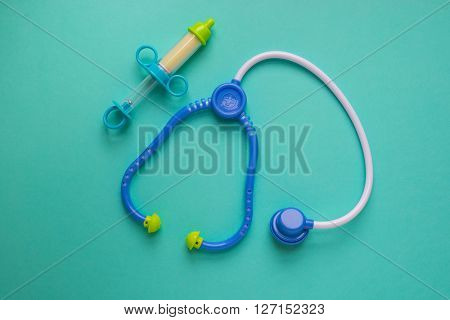 Toy doctor tools. A stethoscope and syringe.