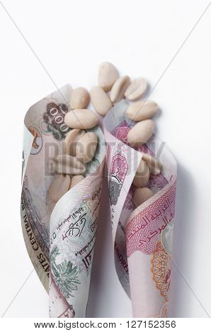 Peanuts rolled in the currency notes. - An idea. 'Peanuts' and currency notes.