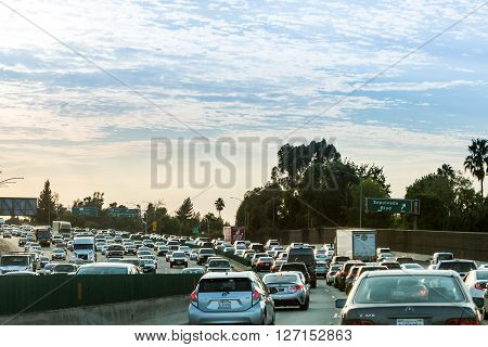 VENTURA FREEWAY, SHERMAN OAKS, USA - SEPTEMBER 11, 2015: Views of the traffic on the Ventura Freeway at sunset on September 11, 2015. The Ventura Freeway is a part of the Route 101 the longest in California.