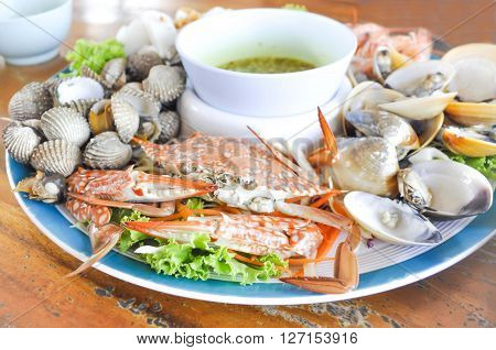 steamed crab and steamed shell dish on the table