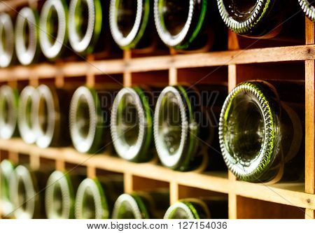 Wine bottles stacked , on wooden racks