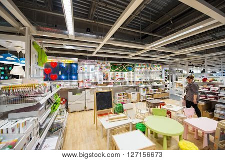 PARIS FRANCE - APR 12 2016: Woman choosing kids furniture in IKEA Shoping furniture store in PAris France