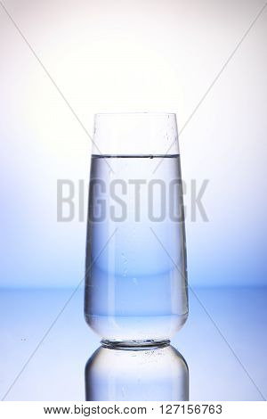 Two-thirds Full Drinking Glass With Reflection