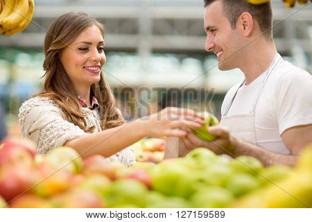 smile and salesman with apple