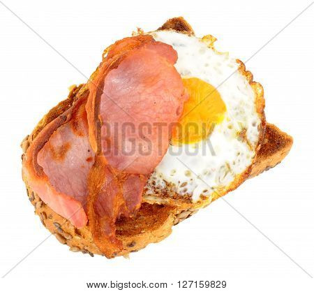 Fried Egg And Bacon rashers on toast isolated on a white background