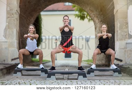group of women stepping training on stepper outdoor