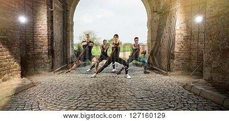group of people exercise using resistance bands outdoor
