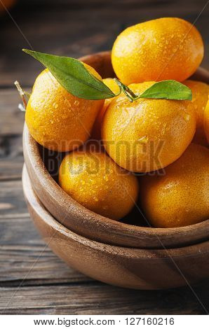Sweet Fresh Tangerine On The Wooden Table
