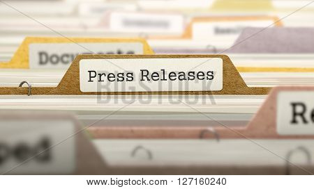 Press Releases on Business Folder in Multicolor Card Index. Closeup View. Blurred Image. 3D Render.