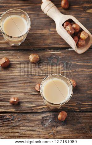 Italian Hazelnuts Liqueur On The Wooden Table