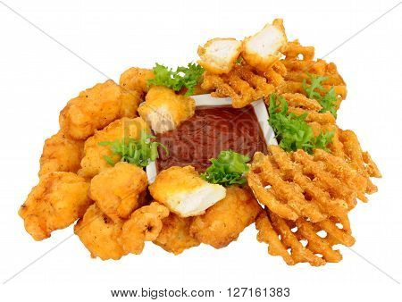 Group of fried battered chicken nugget bites and lattice fries with tomato dipping sauce isolated on a white background