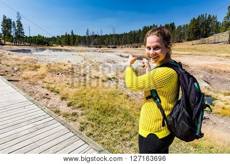 Girl in yellow pullover in the Yellowstone National Park, Wyoming, USA in August 2015