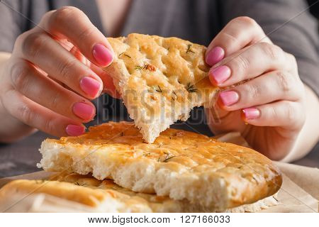 One Piece of bread in woman hands