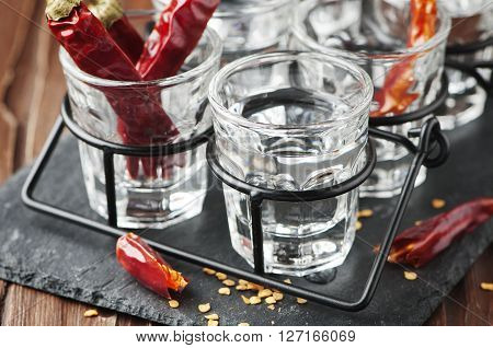 Chili Peppers And Glasses Of Vodka