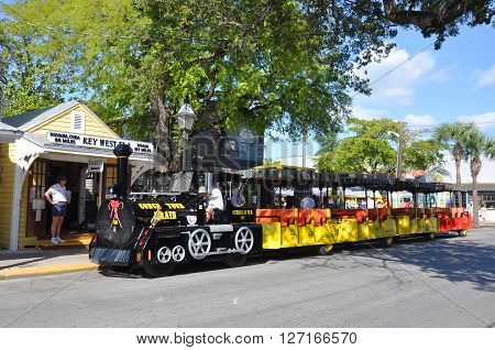 KEY WEST, FL, USA - DEC 20: Key West Conch Tour Train on Dec 20, 2012 in downtown Key West, Florida, USA.