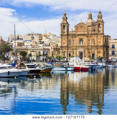 Landmarks of Malta - Msida cathedral and marina with the sail boats